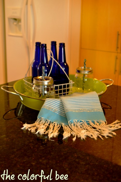 cobalt blue bottles, pale blue kitchen towels and green tray for beachy decoration in kitchen