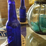 blue bottles and beachglass tablescape