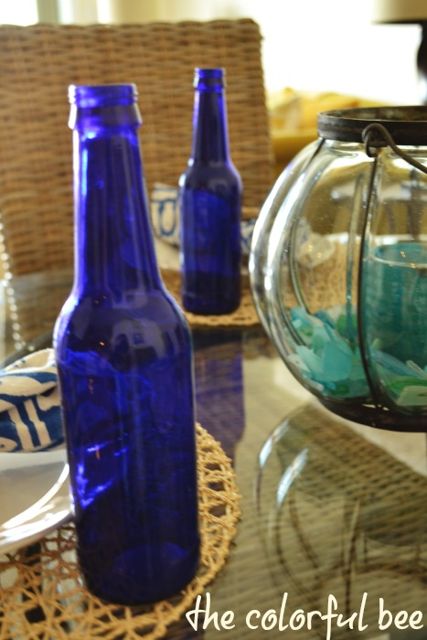 blue bottles and beachglass tablescape
