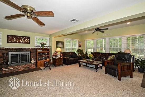 family room with furniture lined along the perimeter