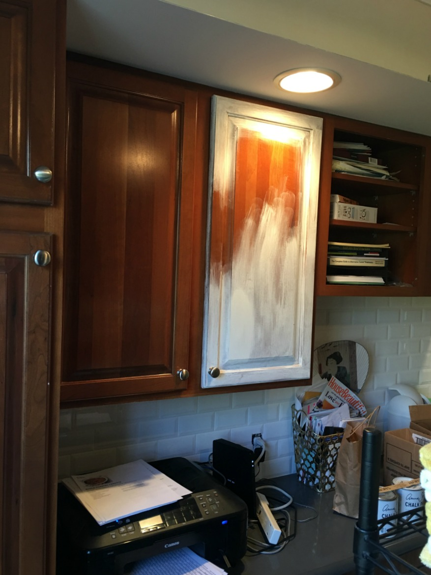 client trying to paint with chalk paint on cabinets